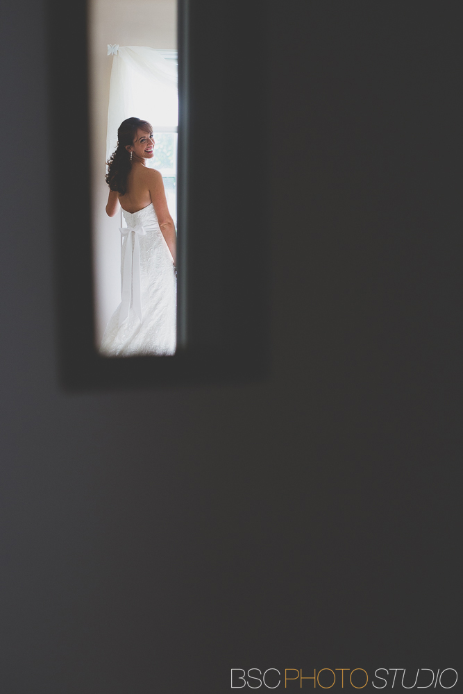 Modern unique CT wedding documentary photojournalism bride looking in mirror