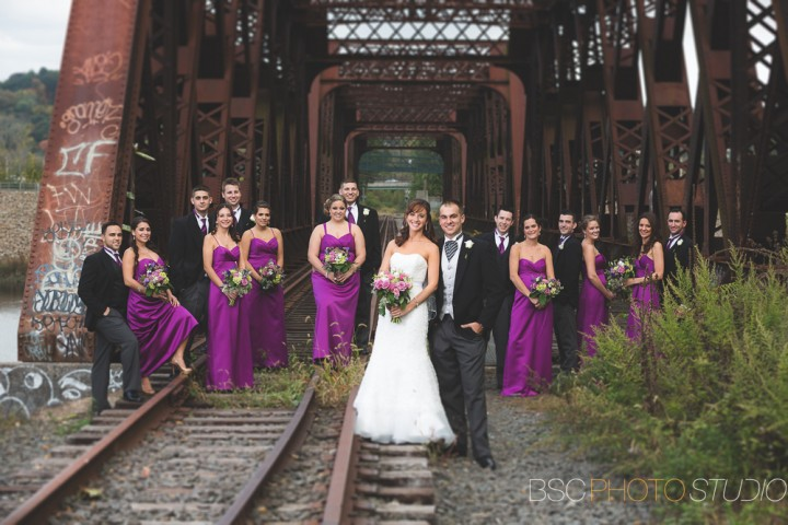 Modern and unique wedding party phtotos at the Old train track bridge in Shelton Connecticut