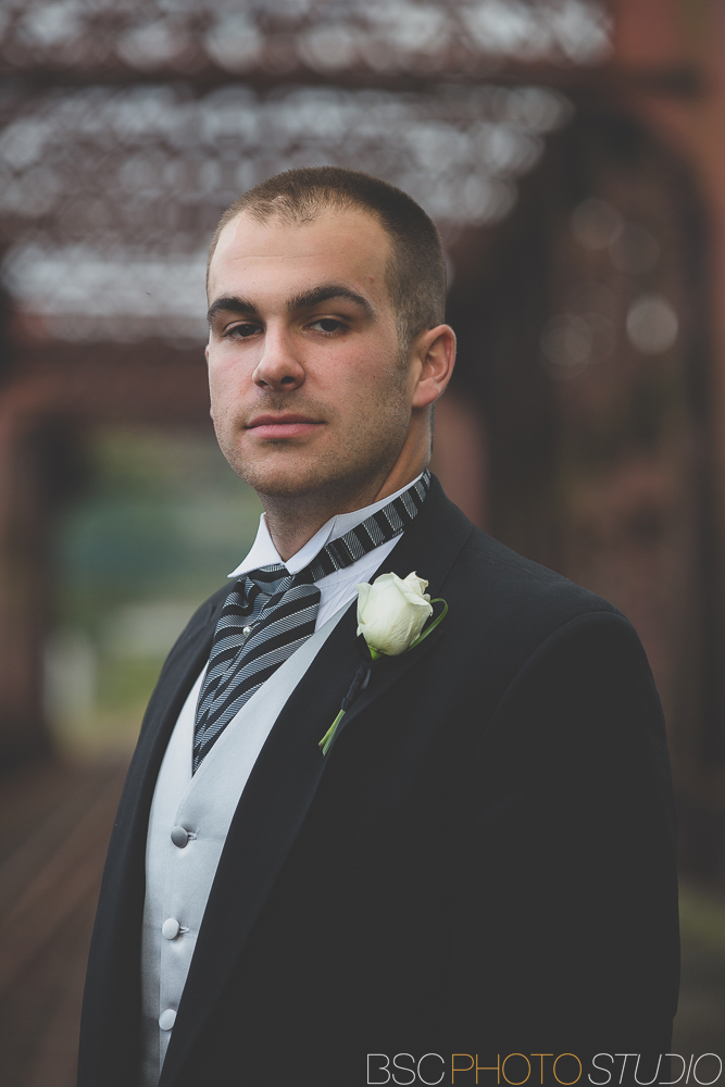 Modern CT documentary wedding photos at the Shelton Old Train Track Bridge Groom portrait
